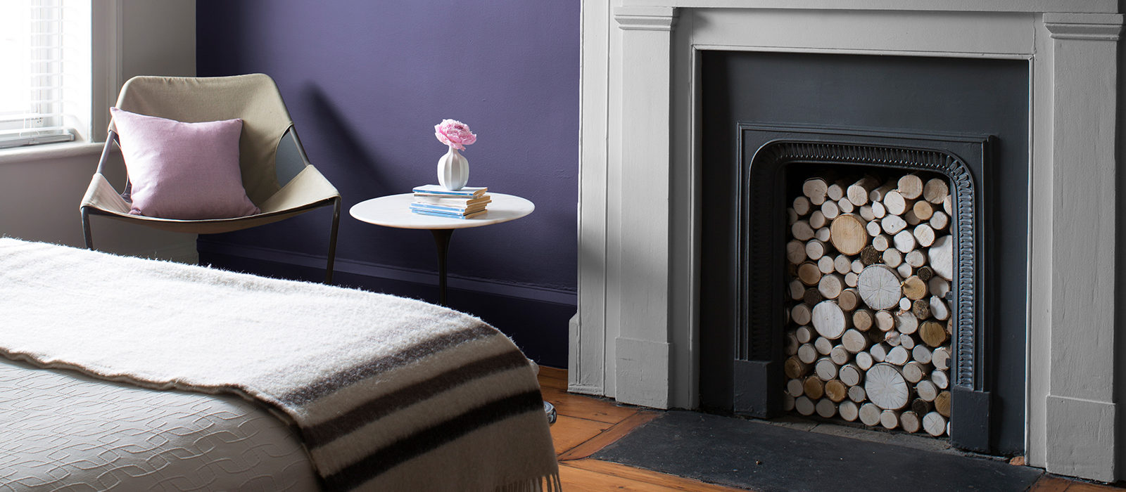 Purple and White Bedroom with Fireplace