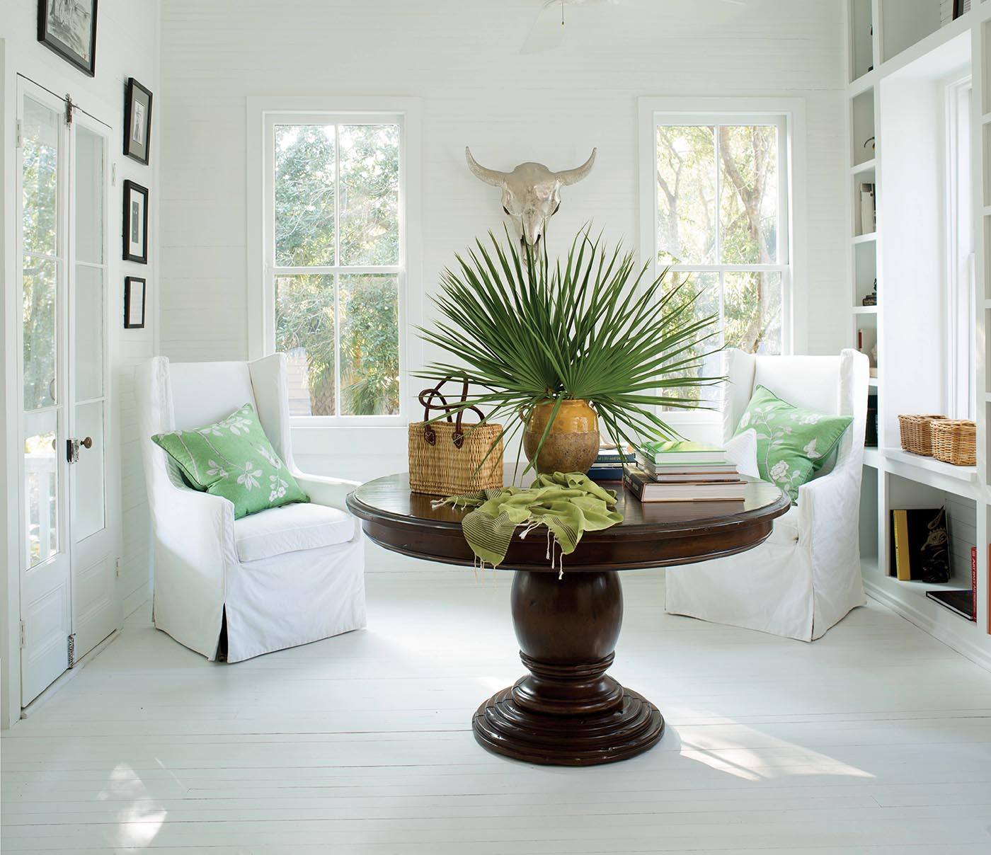 Sunroom with Large Wood Center Table and Plants | Magnolia Paint Company